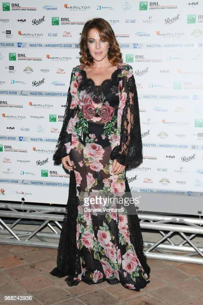 Claudia Gerini attends the Nastri D'Argento cocktail party on June 30 2018 in Taormina Italy