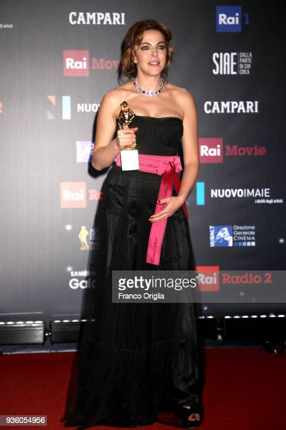 Claudia Gerini poses with the Best Supporting Actress Award at the end of the 62nd David Di Donatello awards ceremony on March 21 2018 in Rome Italy
