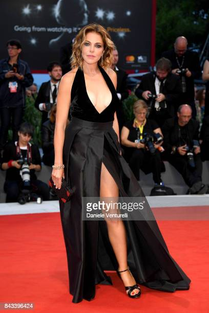 Claudia Gerini walks the red carpet ahead of the 'Ammore E Malavita' screening during the 74th Venice Film Festival at Sala Grande on September 6...