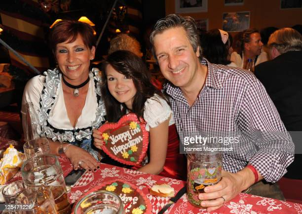 Claudia Jung and her husband Hans Singer and daughter Anna Singer attend the Oktoberfest beer festival at Hippodrom beer tent on September 17 2011 in...