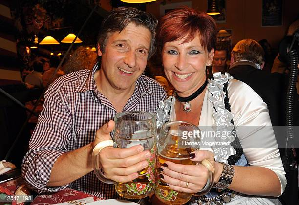 Claudia Jung and her husband Hans Singer attend the Oktoberfest beer festival at Hippodrom beer tent on September 17 2011 in Munich Germany