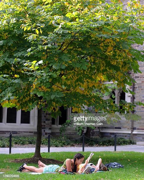 Claudia Kelley of San Francisco California and Cameron Langford of Davidson North Carolina lay on the grass and read in a courtyard at Princeton...