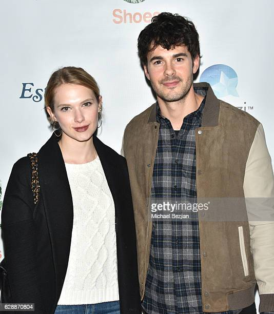 Claudia Lee and actor Jayson Blair arrive at Not For Sale x Z Shoes Benefit at Estrella Sunset on December 9, 2016 in West Hollywood, California.