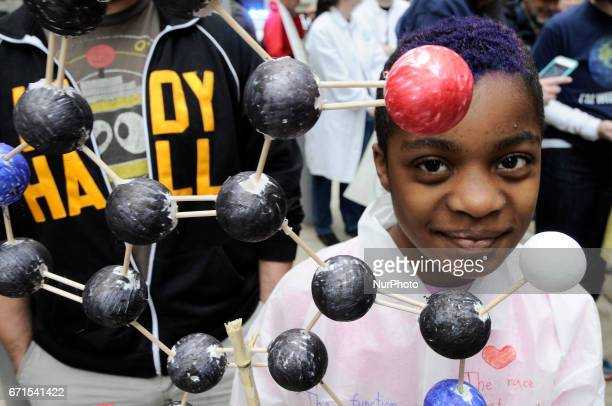 Claudia LevinDorko of Philadelphia shows a model of a Melanin molecule as he participates with his family in the National March for Science on Earth...