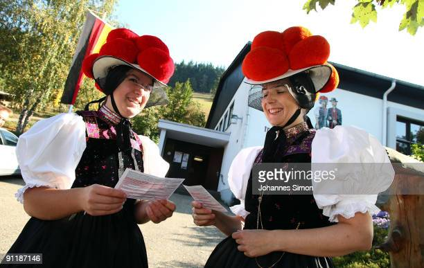 Claudia Lutz and Christiane Huber of Kirnbacher Kurrende Black Forest costume club arrive for casting their vote for the German federal elections on...
