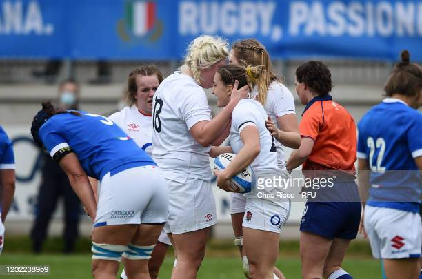 Claudia MacDonald of England celebrates with teammates Bryony Cleall of England and Zoe Aldcroft of England after scoring a try during the Women's...