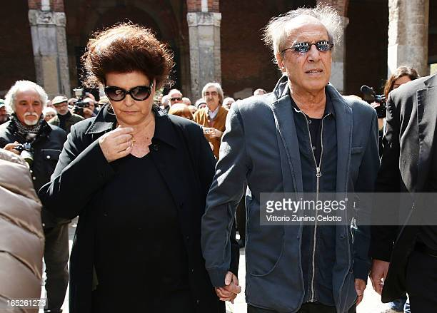 Claudia Mori and Adriano Celentano attend the funeral of Singer Enzo Jannacci at Basilica di Sant'Ambrogio on April 2 2013 in Milan Italy