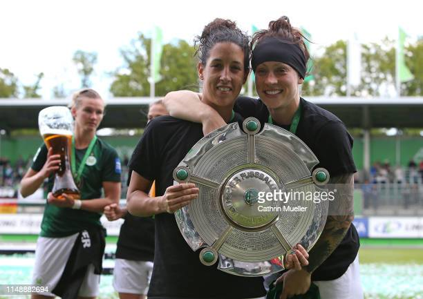 Claudia Neto and Ella Masar of VfL Wolfsburg celebrate their championship victory after the Allianz Frauen Bundesliga match between VfL Wolfsburg and...