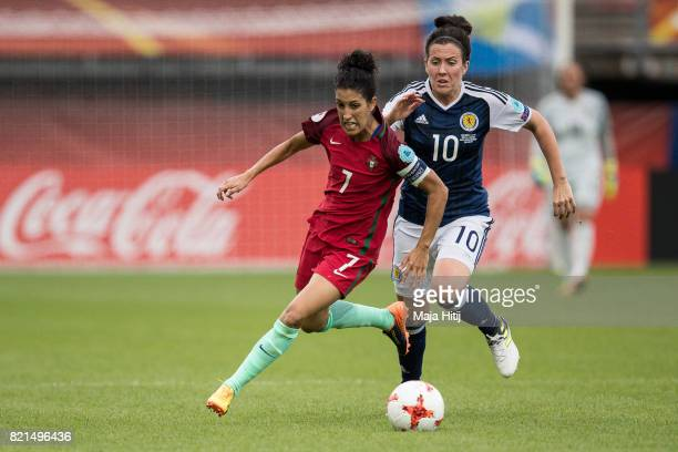 Claudia Neto of Portugal and Leanne Crichton of Scotland battle for the ball during the UEFA Women's Euro 2017 Group D match between Scotland v...