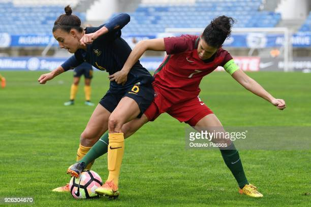 Claudia Neto of Portugal competes for the ball with Chloe Logarzo of Australia during the Women's Algarve Cup Tournament match between Portugal and...