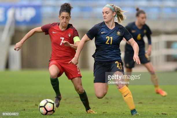 Claudia Neto of Portugal competes for the ball with Ellie Carpenter of Australia during the Women's Algarve Cup Tournament match between Portugal and...