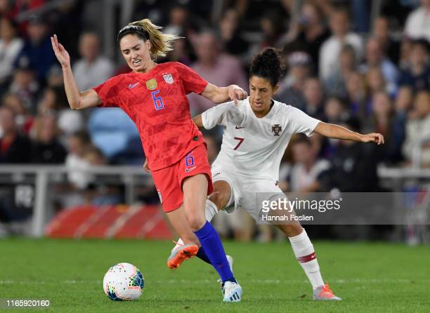 Claudia Neto of Portugal defends against Morgan Brian of the United States during the second half of the USWNT Victory Tour friendly at Allianz Field...