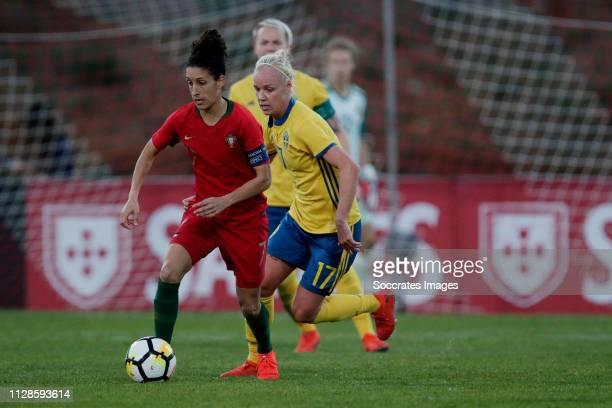 Claudia Neto of Portugal Women Caroline Seger of Sweden Women during the Algarve Cup Women match between Portugal v Sweden at the Estadio Municipal...