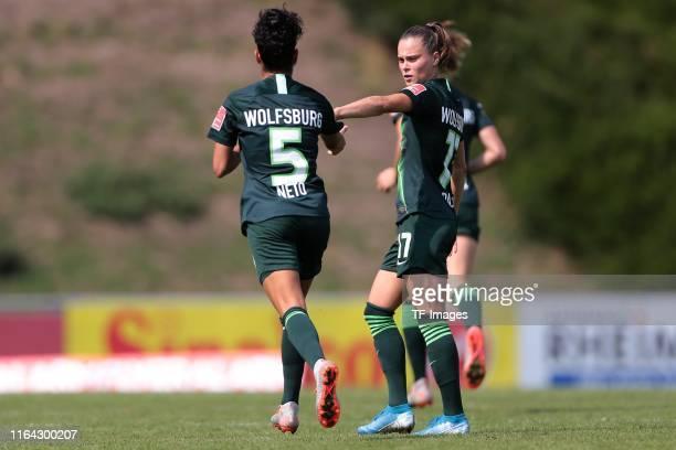 Claudia Neto of VfL Wolfsburg and Ewa Pajor of VfL Wolfsburg celebrate after scoring his team's first goal during the FLYERALARM Frauen Bundesliga...