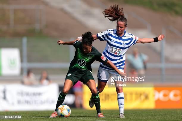 Claudia Neto of VfL Wolfsburg and Kathleen Radtke of MSV Duisburg battle for the ball during the FLYERALARM Frauen Bundesliga match between MSV...