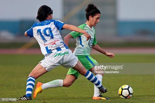 Claudia Neto of VfL Wolfsburg challenges Mizuki Nakamura of SC Huelva during the friendly match between VfL Wolfsburg Women's and SC Huelva Women's...