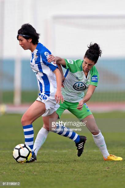 Claudia Neto of VfL Wolsburg Women Chalenges Mizuki Nakamura of SC Huelva during the friendly match between VfL Wolfsburg Women's and SC Huelva...