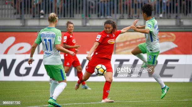Claudia Neto of Wolfsburg challenges Amber Hearn of Koeln during the Allianz Frauen Bundesliga match between VfL Wolfsburg and 1 FC Koeln at...