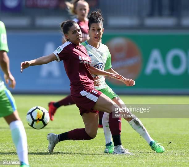 Claudia Neto of Wolfsburg challenges Manjou Wilde of Essen during the Women's DFB Cup Semi Final match between VfL Wolfsburg and SGS Essen at AOK...
