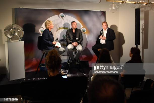 Claudia Neumann Thorsten Fischer CEO of Flyeralarm and Dr Rainer Koch Vice President of DFB attend a Press Conference of the Allianz FrauenBundesliga...