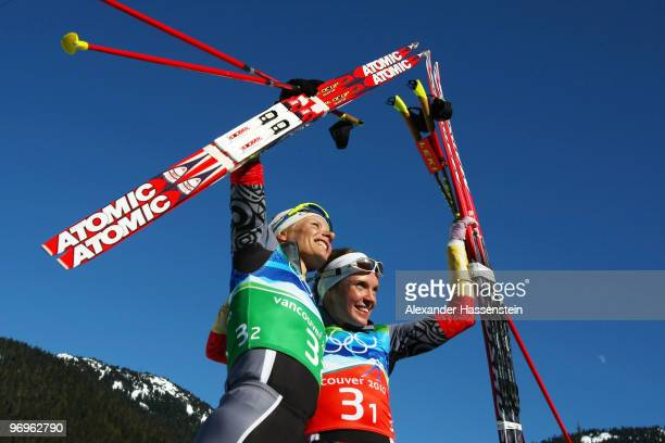 Claudia Nystad and Evi SachenbacherStehle of Germany celebrate crossing winning the gold medal in the cross country skiing ladies team sprint final...