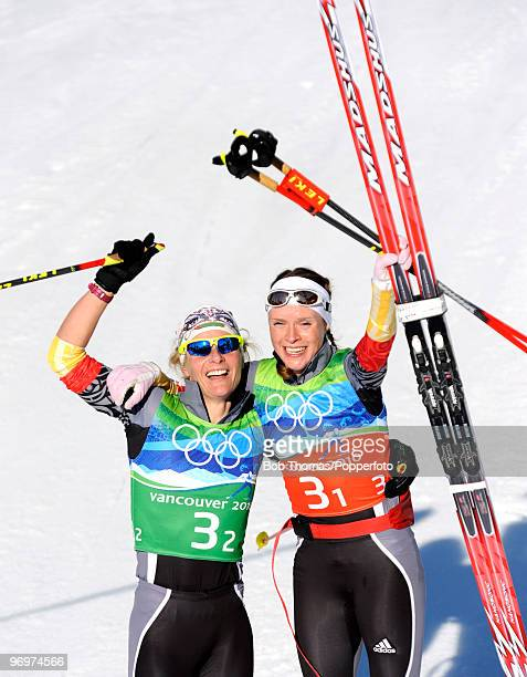 Claudia Nystad and Evi Sachenbacher-Stehle of Germany celebrate winning the gold medal in the cross country skiing ladies team sprint final on day 11...