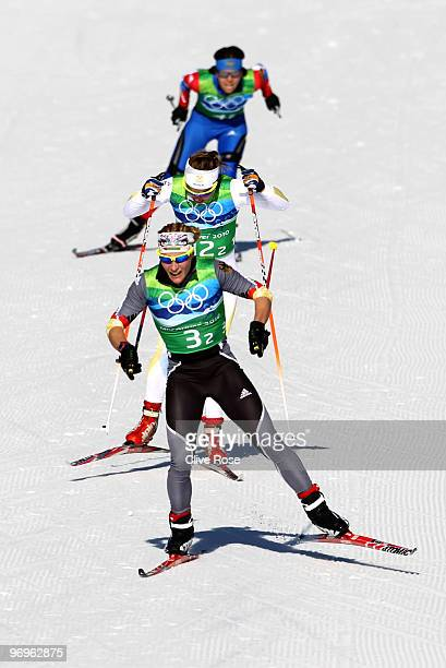 Claudia Nystad of Germany leads Anna Haag of Sweden and Natalia Korosteleva of Russia during the cross country skiing ladies team sprint final on day...