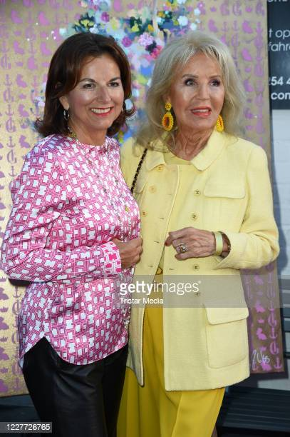 """Claudia Obert and Monika Landsky during the """"Golden Things meets Pink Carpet"""" pre-closing Finissage at Studio 28 on July 21, 2020 in Hamburg, Germany."""