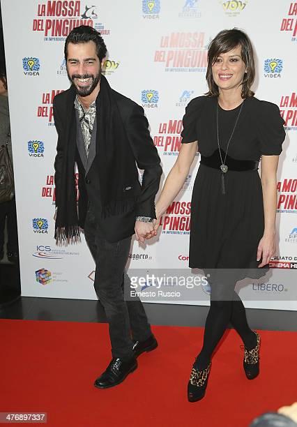 Claudia Pandolfi and boyfriend Marco De Angelis attend the 'La Mossa Del Pinguino' premiere at Cinema Adriano on March 5 2014 in Rome Italy