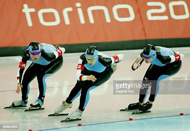 Claudia Pechstein Anni Fiesinger and Daniela Anschuetz Thoms of Germany skate on their way to a Gold Medal against Canada in women's speed skating...