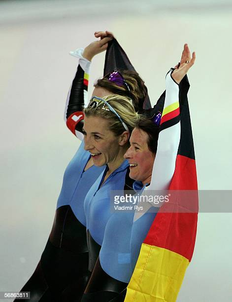 Claudia Pechstein Anni Fiesinger and Daniela Anschuetz Thoms of Germany celebrate winning the Gold Medal against Canada in women's speed skating team...