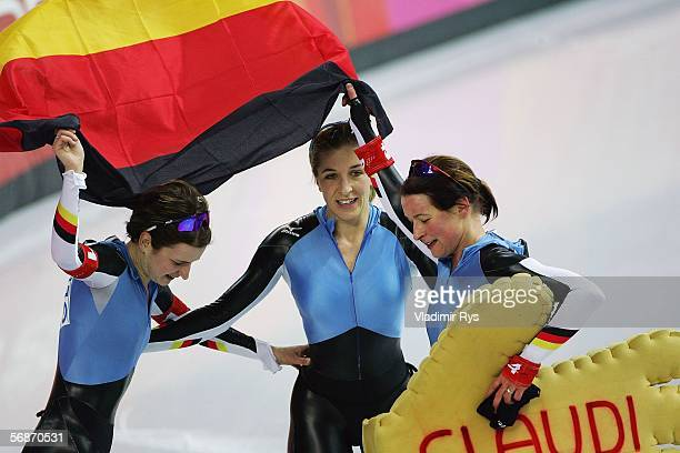 Claudia Pechstein Anni Fiesinger and Daniela Anschuetz Thoms of Germany celebrate winning the Gold Medal against Canada in the women speed skating...