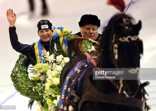 Claudia Pechstein of Germany celebrates winning the European Championships in a carriage after the Essent ISU European Speed Skating Championships at...