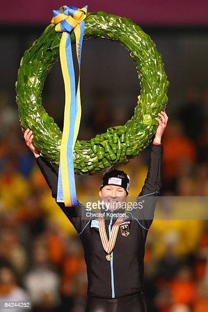 Claudia Pechstein of Germany celebrates winning the European Championships on the podium of the Essent ISU European Speed Skating Championships at...