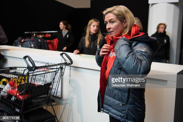 Claudia Pechstein tries on a jacket during the 2018 PyeongChang Olympic Games German Team Kit Handover at Postpalast on January 11 2018 in Munich...