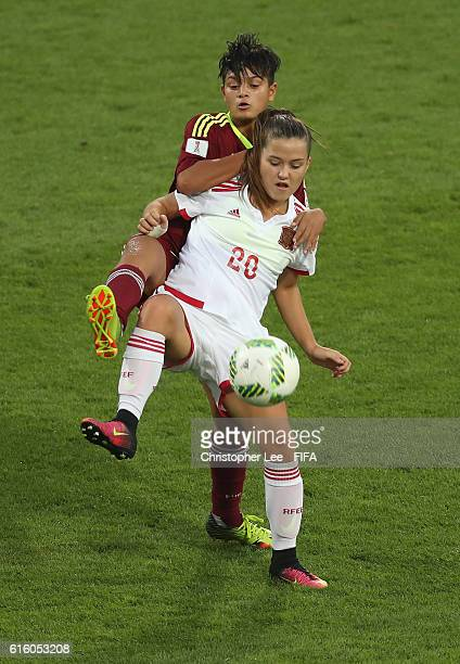 Claudia Pina of Spain holds off Hilary Vergara of Venezuela during the FIFA U17 Women's World Cup Jordan 2016 Third Place PlayOff match between...