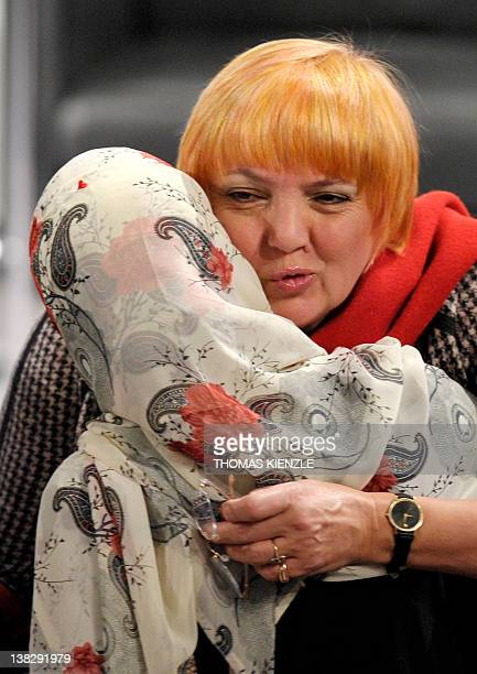 Claudia Roth coleader of the German Green party hugs Nobel Peace Prize Laureate Tawakkul Karman during the 48th Munich Security Conference at the...