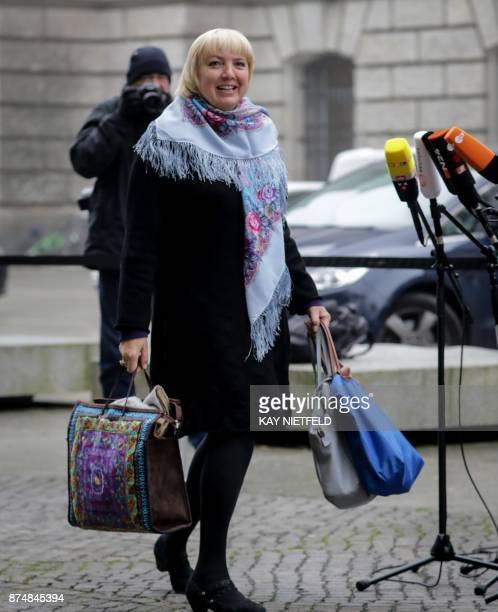 Claudia Roth one of the Bundestag's vice presidents and politician of the Greens carries bags as she arrives for further exploratory talks with...