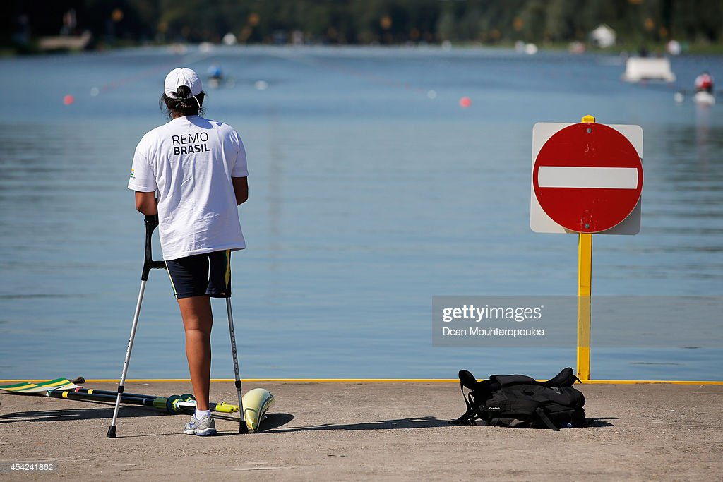 Claudia Santos of Brazil gets up after she competes in the AS Women's Single Sculls during the 2014 World Rowing Championships at the Bosbaan on August 27, 2014 in Amsterdam, Netherlands.