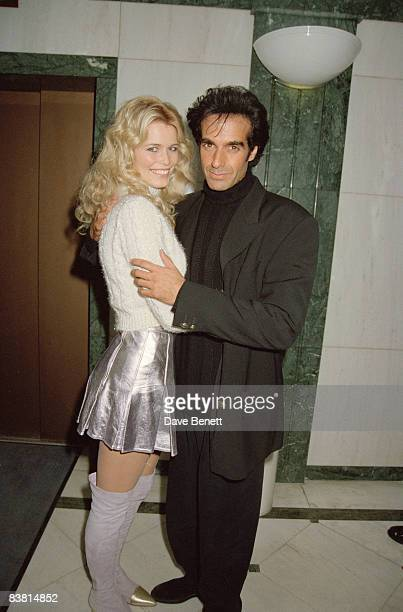Claudia Schiffer and David Copperfield attend a party at Kensington Roof Gardens in London 1st November 1994