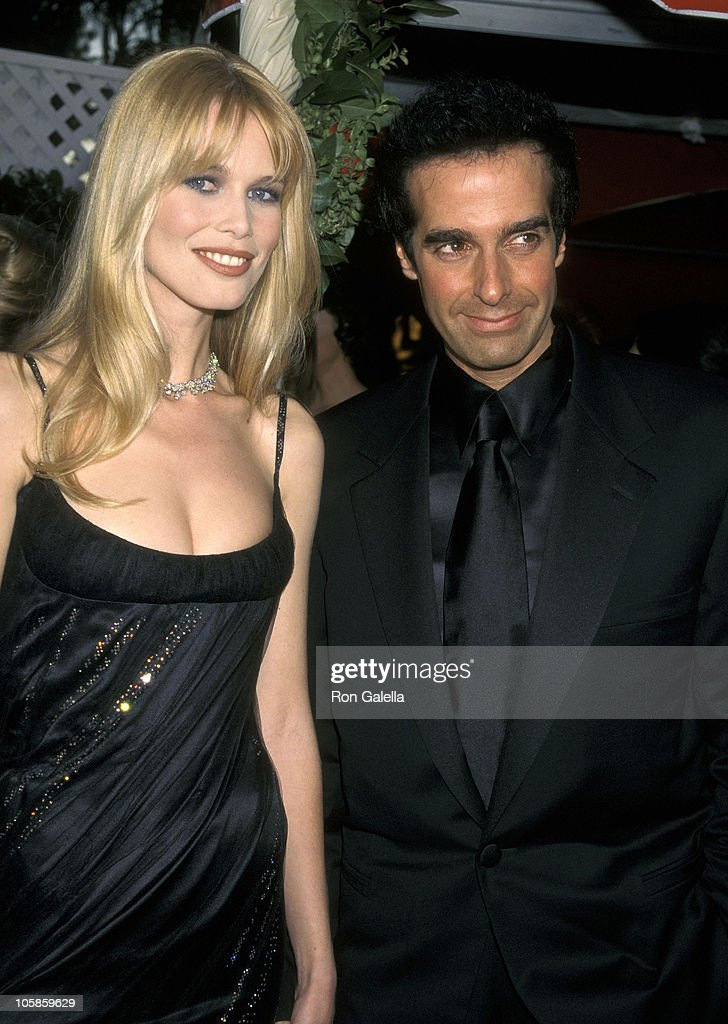 Claudia Schiffer and David Copperfield during The 70th Annual Academy Awards - Red Carpet at Shrine Auditorium in Los Angeles, California, United States.