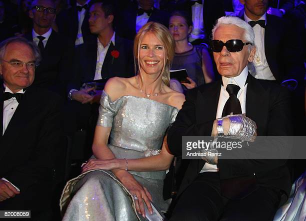 Claudia Schiffer and Karl Lagerfeld attend the award ceremony of ELLE Fashion Star during the Mercedes Benz Fashion week spring/summer 2009 at the...
