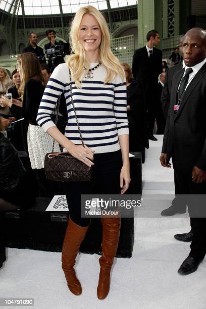 Claudia Schiffer attends the Chanel Ready to Wear Spring/Summer 2011 show during Paris Fashion Week at Grand Palais on October 5 2010 in Paris France