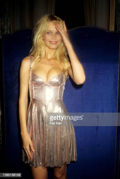 Claudia Schiffer dances during a Gianni Versace Party during A Paris Fashion Weeks in the 1990s in Paris, France.