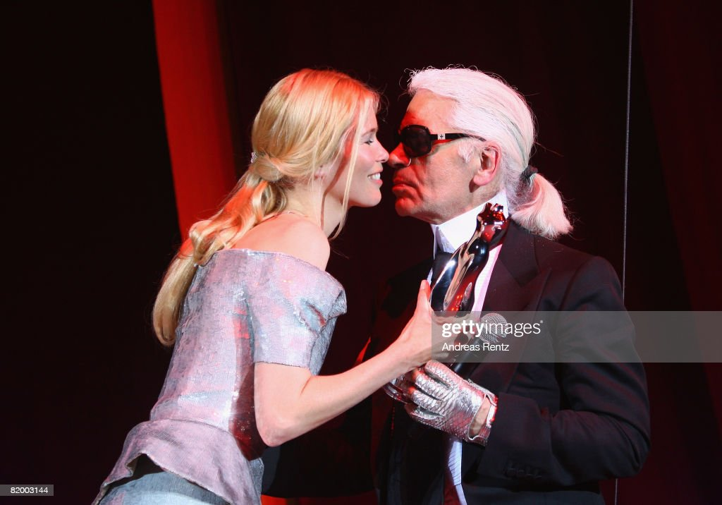 Claudia Schiffer hands Karl Lagerfeld the Platinum award at the ELLE Fashion Star award ceremony during the Mercedes Benz Fashion week spring/summer 2009 at the Tempodrom on July 19, 2008 in Berlin, Germany.