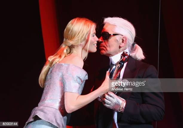 Claudia Schiffer hands Karl Lagerfeld the Platinum award at the ELLE Fashion Star award ceremony during the Mercedes Benz Fashion week spring/summer...