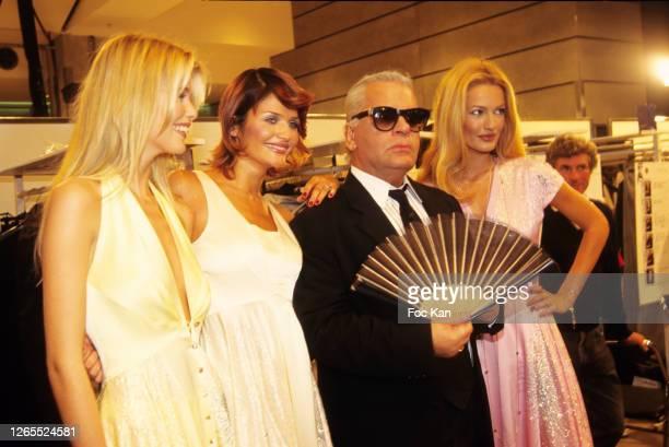 Claudia Schiffer, Helena Christensen, Karl Lagerfeld and Karen Mulder attend a Chanel Show during Paris Fashion Week in the 1990s in Paris, France.
