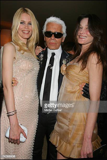 Claudia Schiffer Karl Lagerfeld and Carla Bruni attend a dinner sponsored by magazine Madame Figaro to celebrate the Sixtieth Anniversary of the IFF...