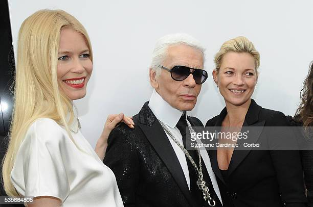 Claudia Schiffer Karl Lagerfeld and Kate Moss attend the Chanel ReadytoWear A/W 2009/10 fashion show during Paris Fashion Week at Grand Palais in...