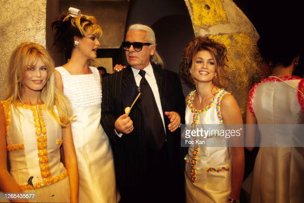 Claudia Schiffer, Linda Evangelista, Karl Lagerfeld and models attend a Chanel show during Paris Fashion Week in the 1990s in Paris, France.